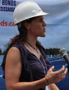 "Judy presenting at the ribbon-cutting of SolarShare's ""Waterview"" project, in 2011"